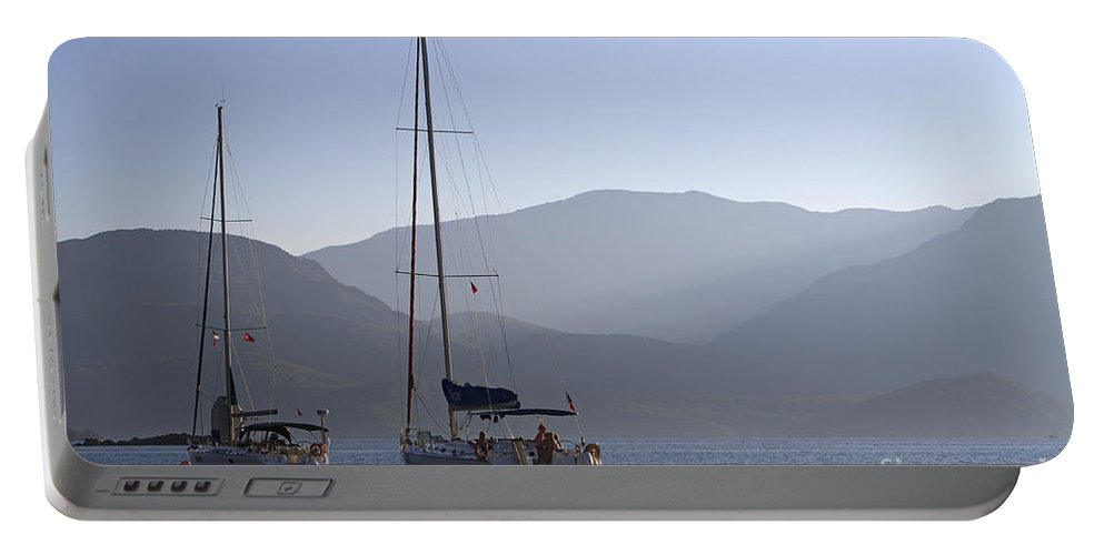 Sailing Portable Battery Charger featuring the photograph Sailing Boats At Dawn In Karacaoren Bay by Louise Heusinkveld
