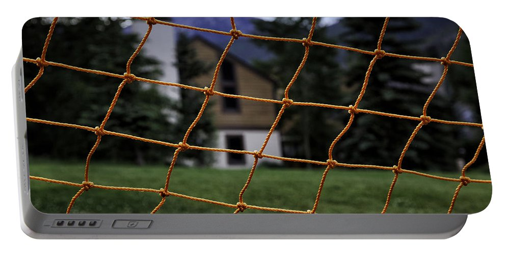 House Portable Battery Charger featuring the photograph Scene Through A Volley Ball Court 2 by Madeline Ellis