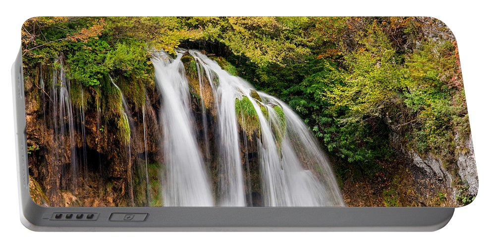 Waterfall Portable Battery Charger featuring the photograph Scenic Waterfall by Artur Bogacki