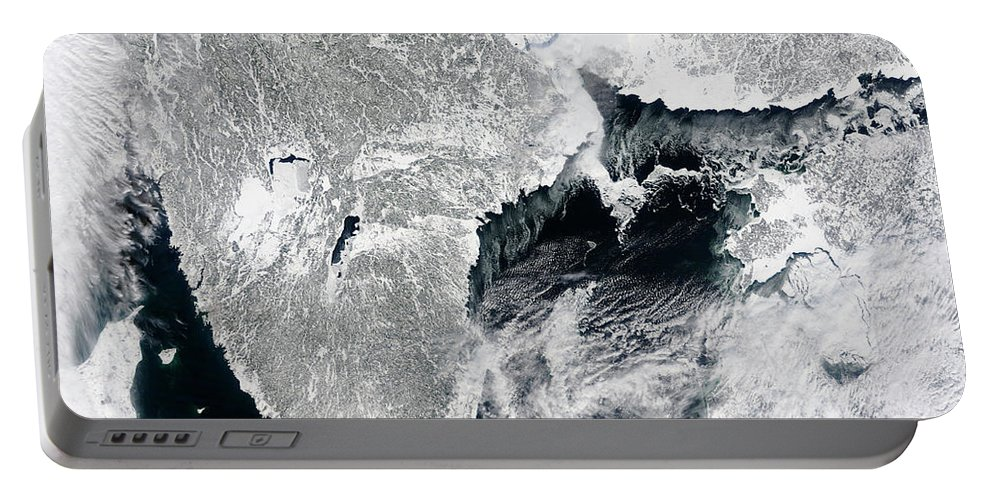 Color Image Portable Battery Charger featuring the photograph Sea Ice Lines The Coasts Of Sweden by Stocktrek Images