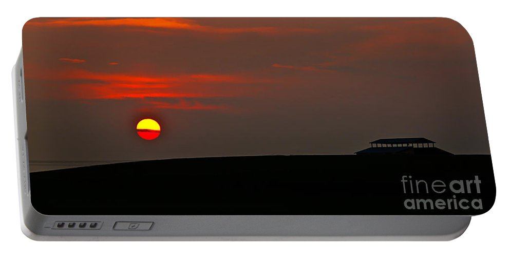 Sunset Portable Battery Charger featuring the photograph Setting Sun by Robert Bales