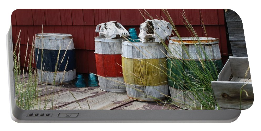 Elizabeth Town Portable Battery Charger featuring the photograph Skulls On Barrels by Ron Weathers