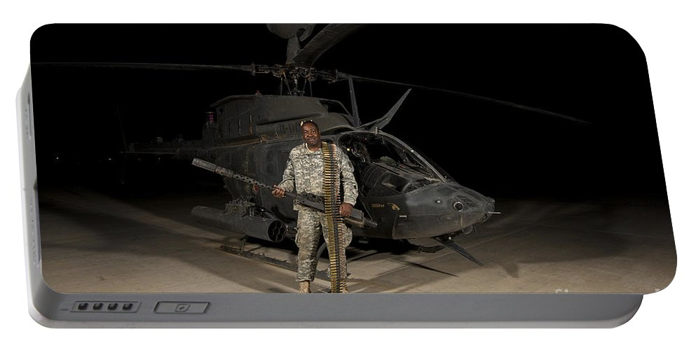 Camp Speicher Portable Battery Charger featuring the photograph Soldier Holding A .50 Caliber Machine by Terry Moore