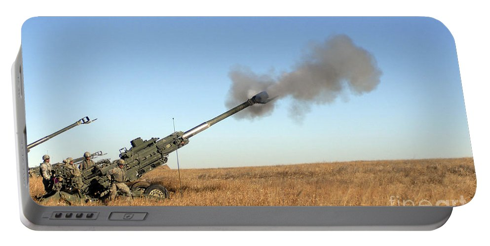 Battalion Portable Battery Charger featuring the photograph Soldiers Fire A 155mm M777 Lightweight by Stocktrek Images