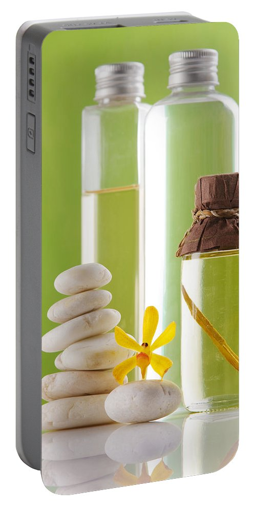 Spa-treatment Portable Battery Charger featuring the photograph Spa Oil Bottles by Atiketta Sangasaeng