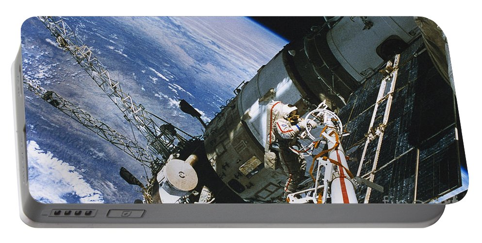 Spacewalk Portable Battery Charger featuring the photograph Spacewalk by Science Source