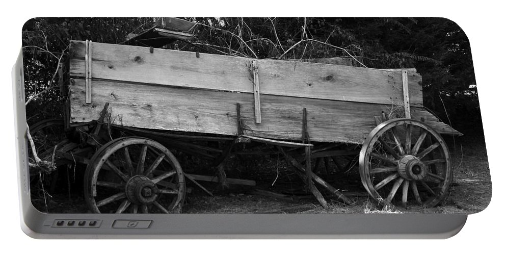 Wagon Portable Battery Charger featuring the photograph Splintered Wheels by Charleen Treasures