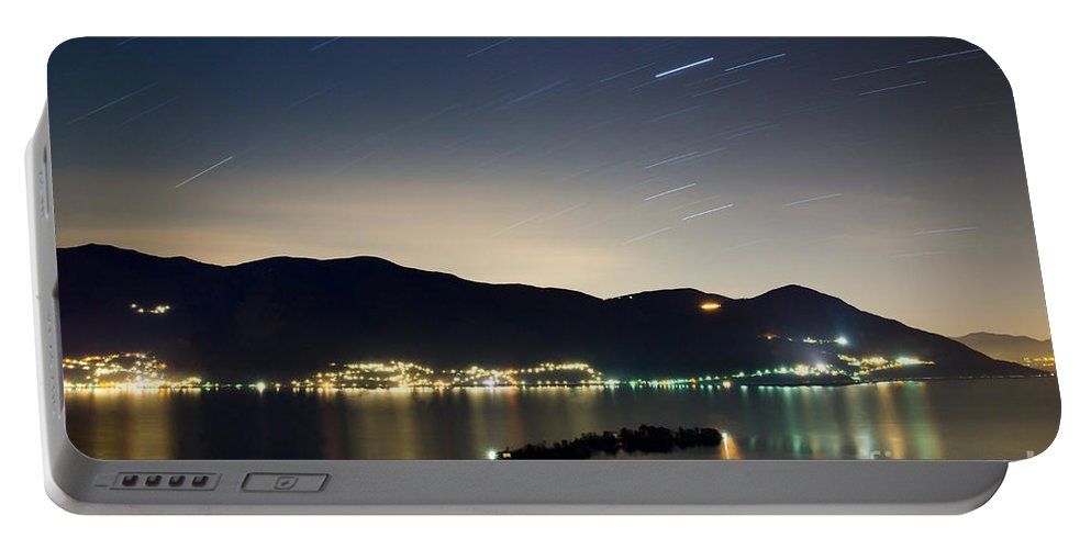 Island Portable Battery Charger featuring the photograph Star Trails by Mats Silvan