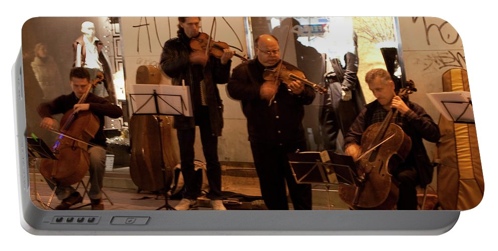 Madrid Portable Battery Charger featuring the photograph Street String Quartet by Lorraine Devon Wilke