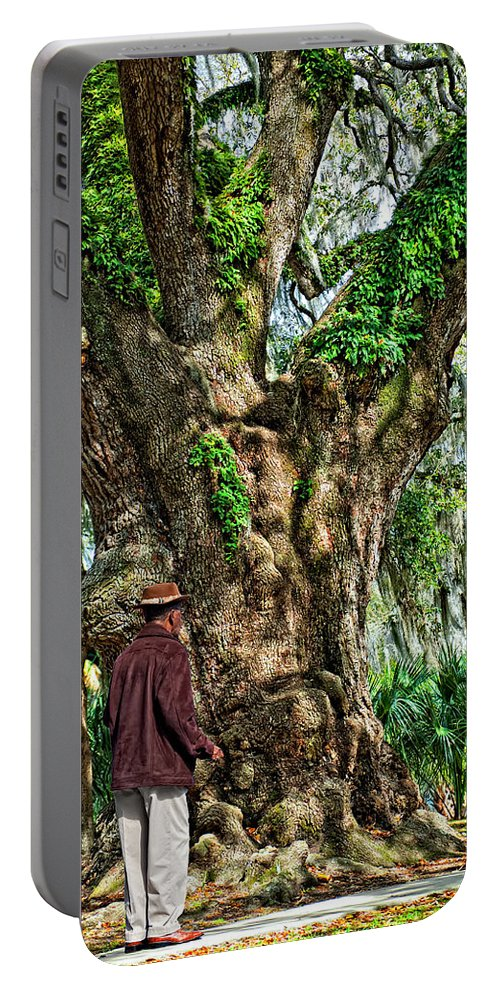 New Orleans Portable Battery Charger featuring the photograph Strolling With Giants by Steve Harrington