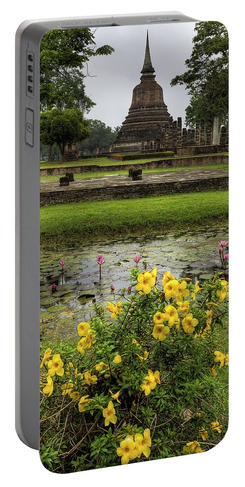 Temple Portable Battery Charger featuring the photograph Sukhothai Historical Park by Adrian Evans