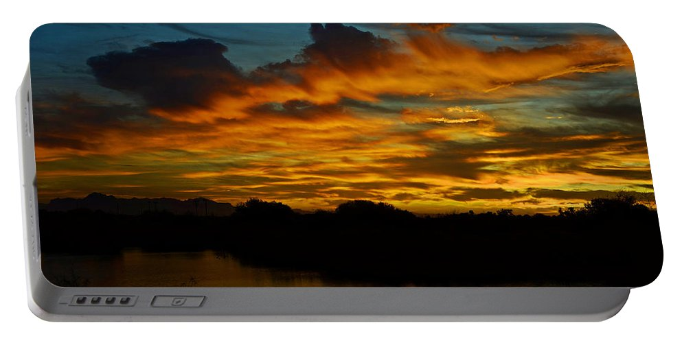Sunrise Portable Battery Charger featuring the photograph Sun Kissed Sky by Saija Lehtonen