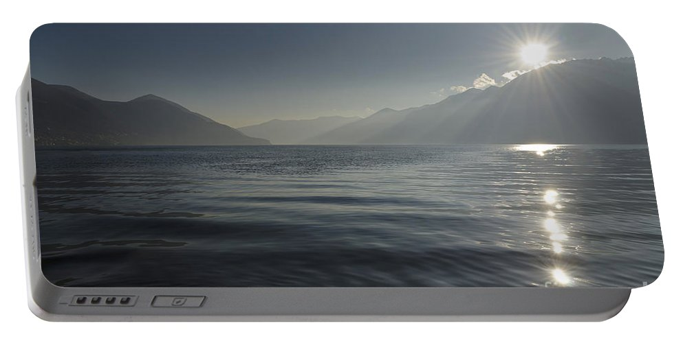 Sun Portable Battery Charger featuring the photograph Sunlight Over An Alpine Lake by Mats Silvan