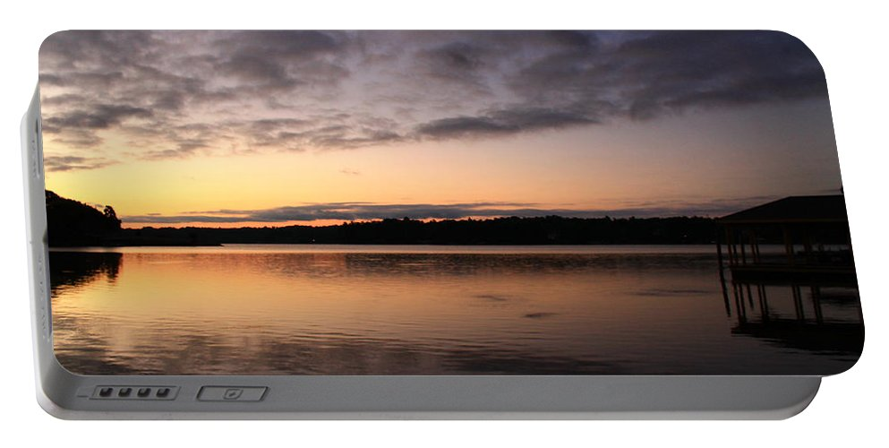 Sunrise Portable Battery Charger featuring the photograph Sunrise And Fish And Docks by Catie Canetti