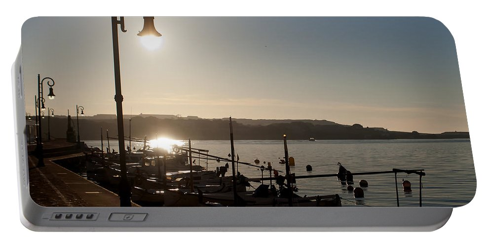 Spain Portable Battery Charger featuring the photograph sunrise - First dawn of a spanish town is Es Castell Menorca sun is a special lamp by Pedro Cardona Llambias