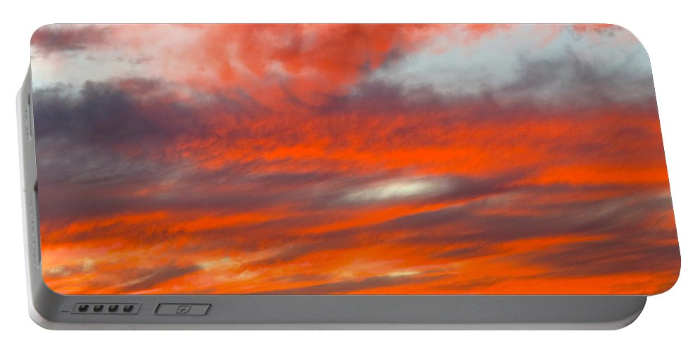 Susnset In Blue Sky Portable Battery Charger featuring the photograph Sunset In Motion by Phyllis Kaltenbach