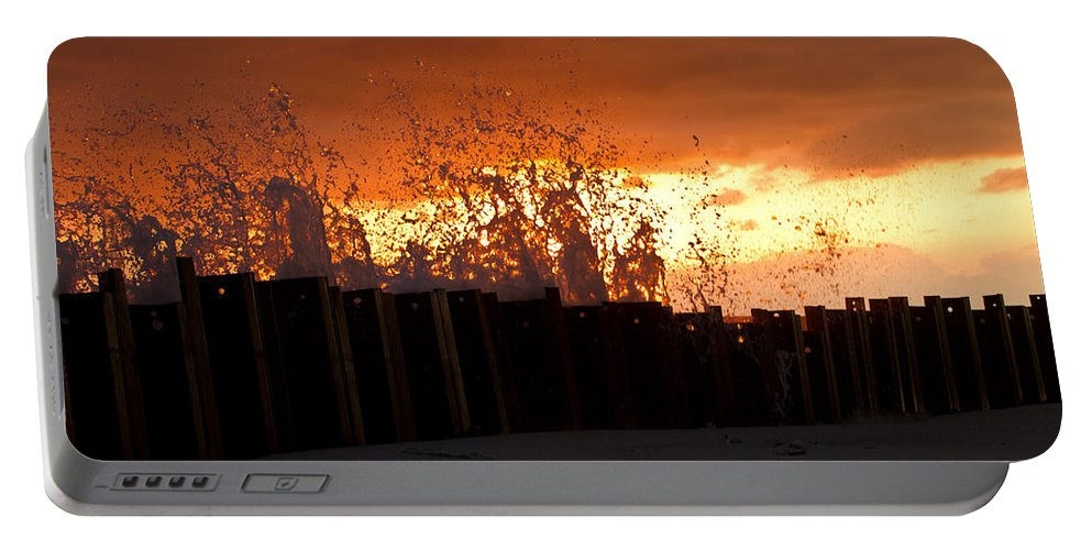 Sun Portable Battery Charger featuring the photograph Sunset Splash 4 by Bill Lindsay