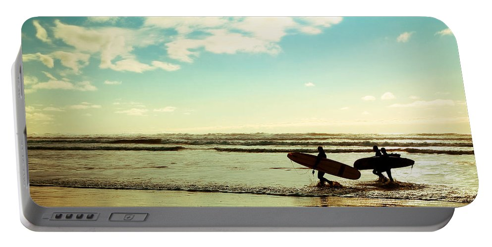 Surfers Portable Battery Charger featuring the photograph Surf At Sunset by Athena Mckinzie