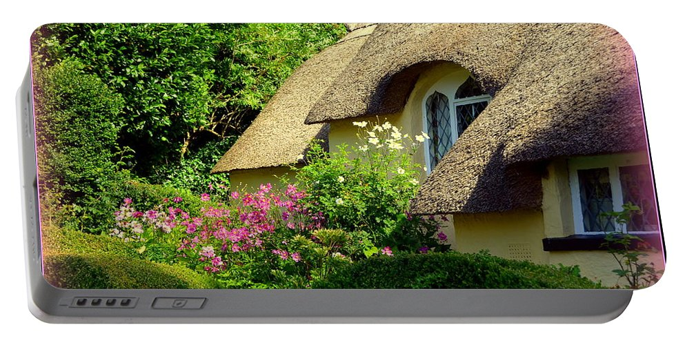 Selworthy Portable Battery Charger featuring the photograph Thatched Cottage With Pink Flowers by Carla Parris