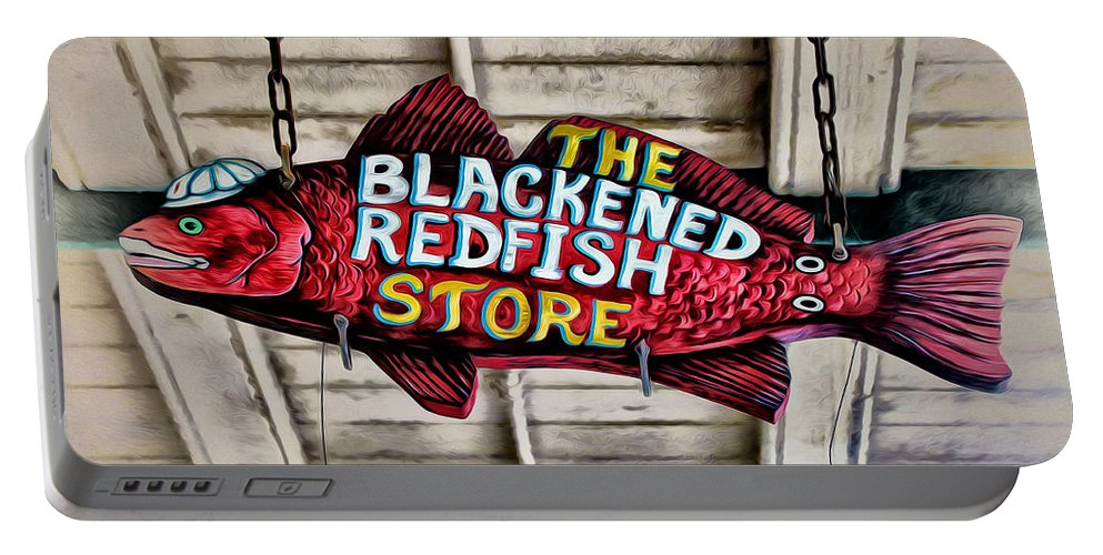 The Blackened Redfish Store Portable Battery Charger featuring the photograph The Blackened Redfish Store by Bill Cannon