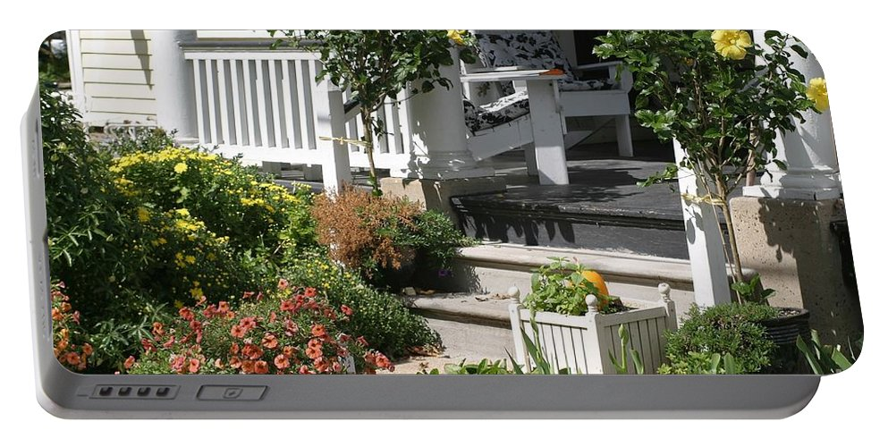 Porch Portable Battery Charger featuring the photograph The Cheerful Porch by Living Color Photography Lorraine Lynch