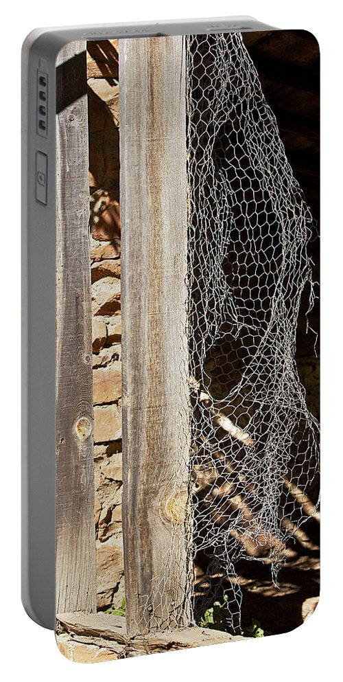 Structure Portable Battery Charger featuring the photograph The Chicken Coop Caper by Phyllis Denton