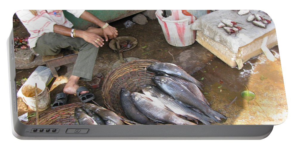 Fish Portable Battery Charger featuring the photograph The Fish Seller by David Pantuso