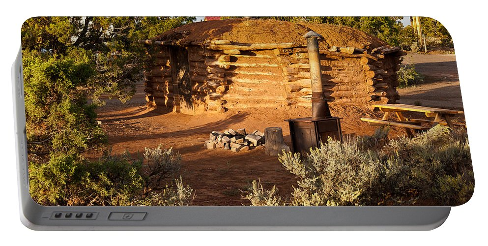 Canyon De Chelly Portable Battery Charger featuring the photograph The Hogan Near Spider Rock by Bob and Nadine Johnston