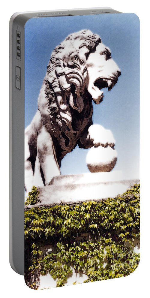 Statue Portable Battery Charger featuring the photograph The Lion by Mike Nellums