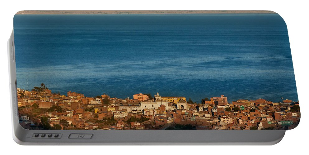 Copacabana Portable Battery Charger featuring the photograph The Population Of Copacabana On The Shores Of Lake Titicaca. Republic Of Bolivia. by Eric Bauer