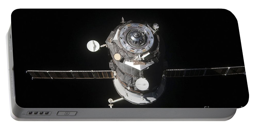 Color Image Portable Battery Charger featuring the photograph The Progress 46 Spacecraft by Stocktrek Images