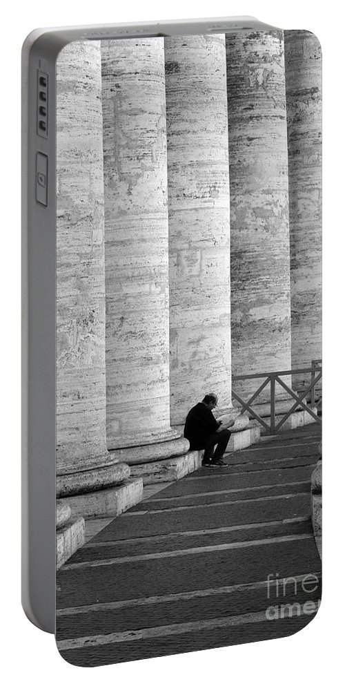 Columns Portable Battery Charger featuring the photograph The Reader Amidst The Columns Bw by Mike Nellums