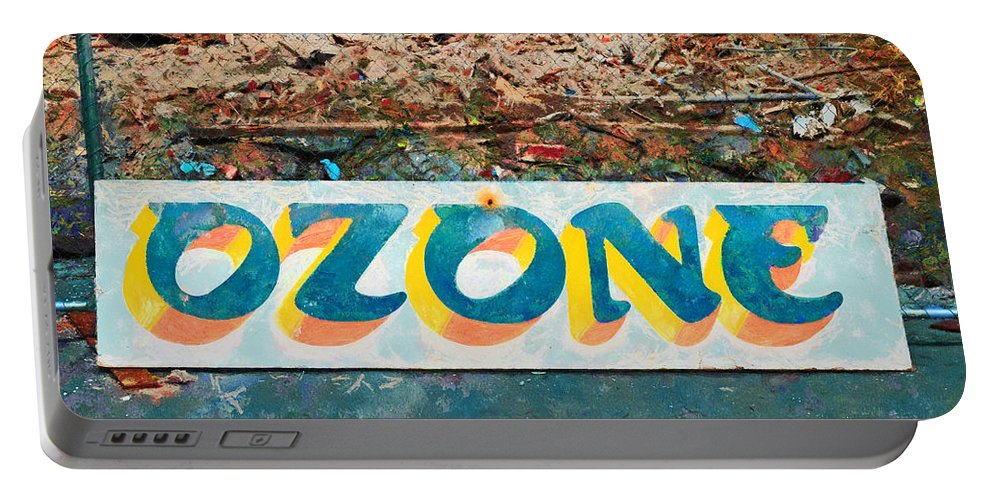 This Sign Was All That Remained After The Demolition Of The Historical Ozone Hotel Portable Battery Charger featuring the photograph The Sign Of The Ozone by Steve Taylor
