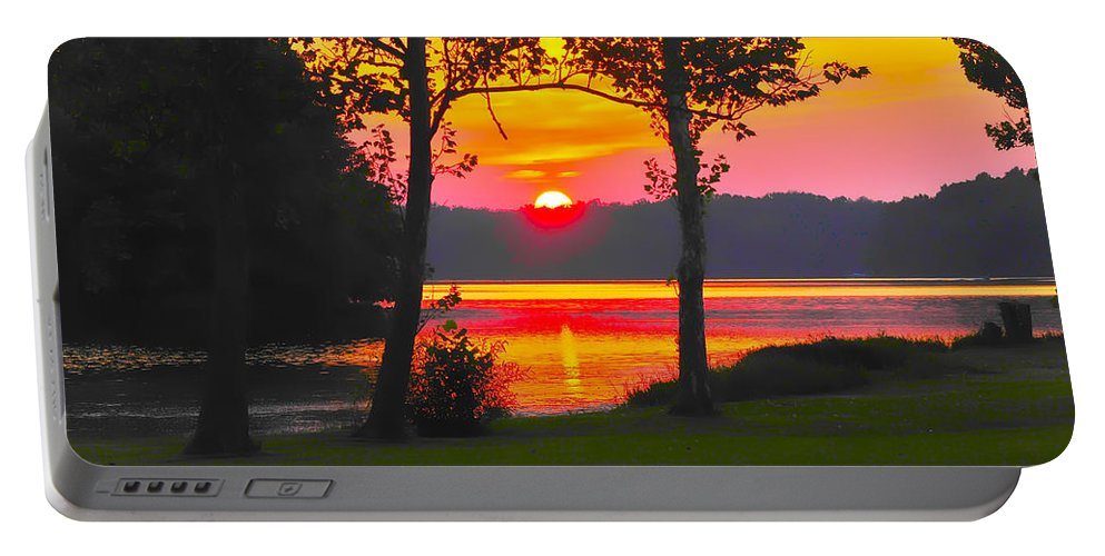 Tranquility Portable Battery Charger featuring the photograph The Smiling Face Sunset by Randall Branham