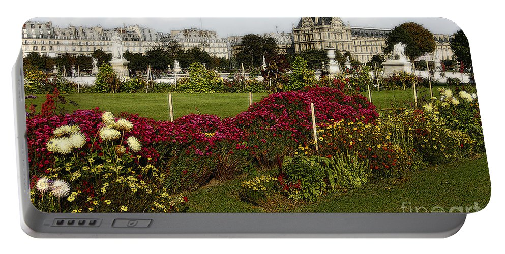 Paris Portable Battery Charger featuring the photograph The Tuilleries Garden In Paris by Mike Nellums