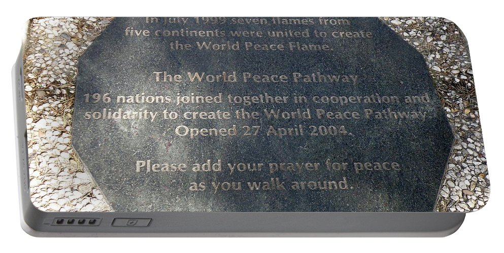 the World Peace Flame Portable Battery Charger featuring the photograph The World Peace Flame by Lainie Wrightson
