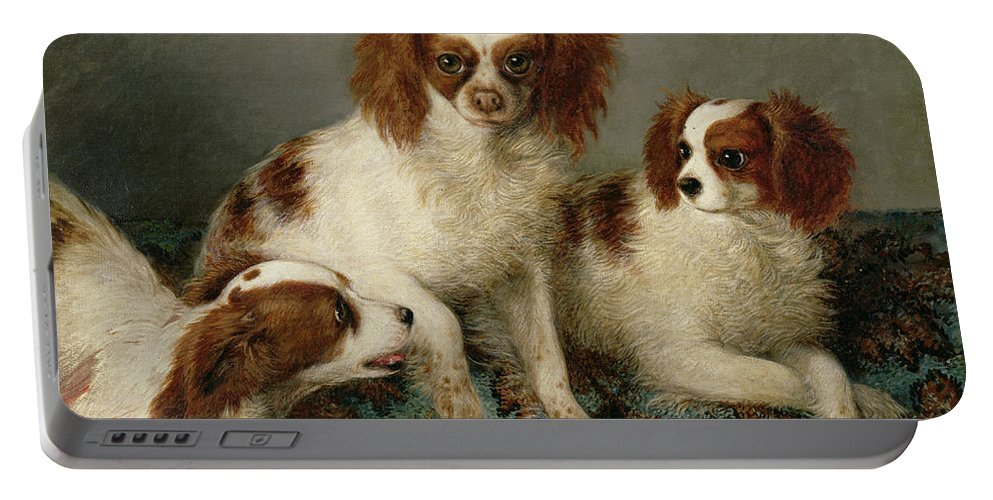 Three Cavalier King Charles Spaniels On A Rug Portable Battery Charger featuring the painting Three Cavalier King Charles Spaniels On A Rug by English School