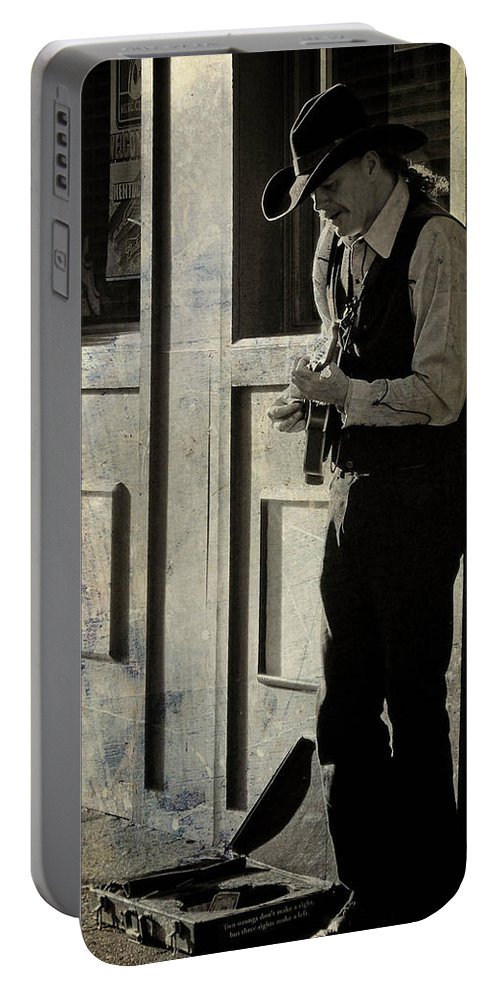 Cowboy Portable Battery Charger featuring the photograph Three Rights Make A Left by Trish Tritz