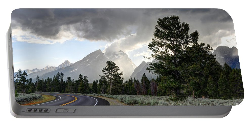 Grand Portable Battery Charger featuring the photograph Thunderstorm On Grand Teton Road by Gary Whitton
