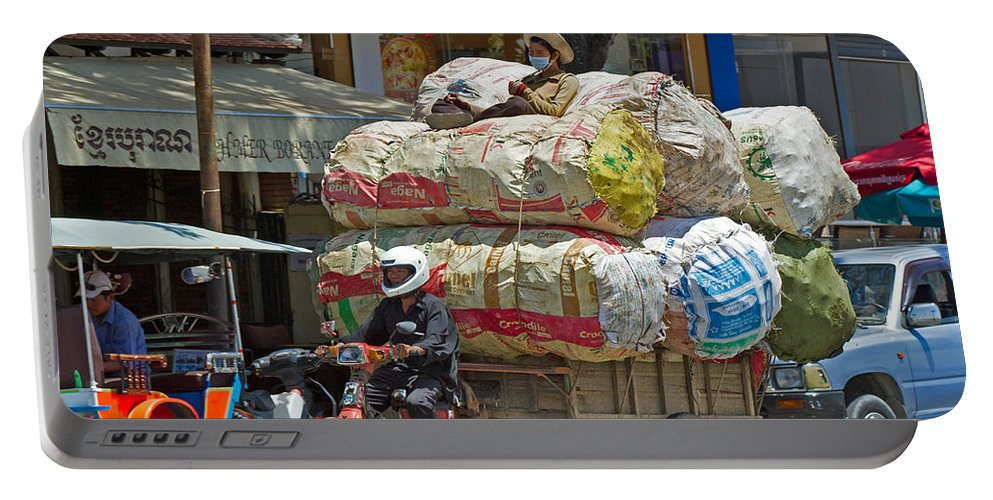 Cambodia Portable Battery Charger featuring the photograph Towing A Big Load by David Freuthal