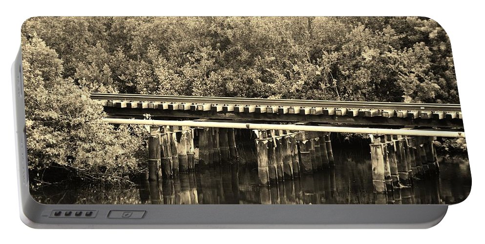 Black And White Portable Battery Charger featuring the photograph Track On The River In Sepia by Rob Hans
