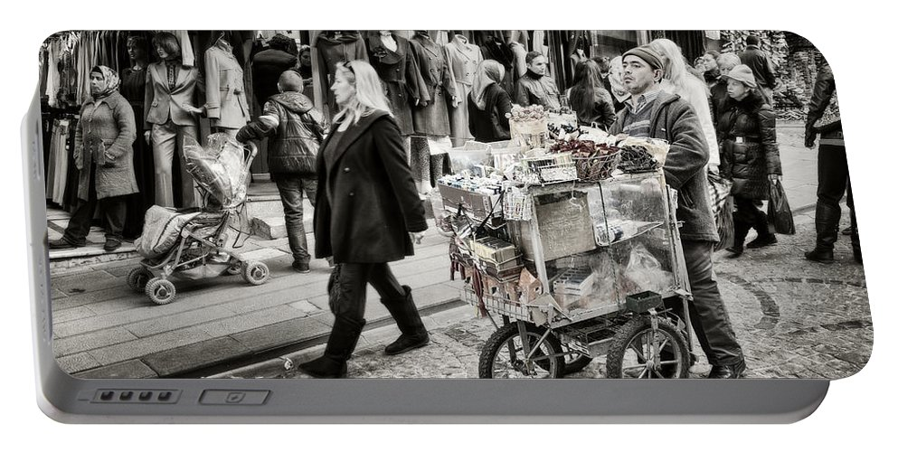 Clothing Portable Battery Charger featuring the photograph Traveling Vendor by Joan Carroll