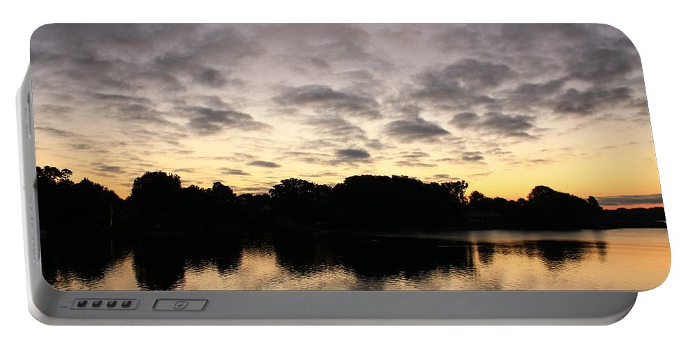 Sunrise Portable Battery Charger featuring the photograph Trees Reflecting by Catie Canetti