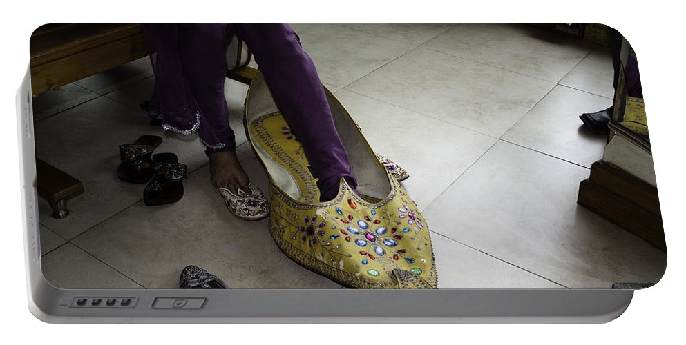 Amritsar Portable Battery Charger featuring the photograph Trying On A Very Large Decorated Shoe by Ashish Agarwal