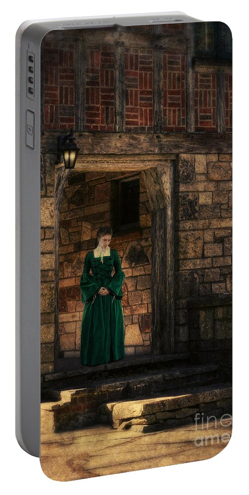 Woman Portable Battery Charger featuring the photograph Tudor Lady In Doorway by Jill Battaglia