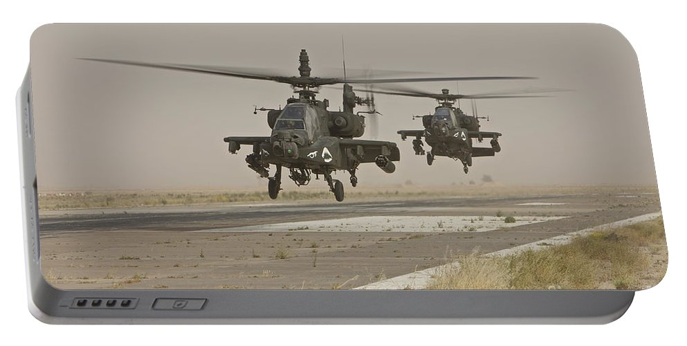 Ah-64 Portable Battery Charger featuring the photograph Two Ah-64 Apache Helicopters Prepare by Terry Moore