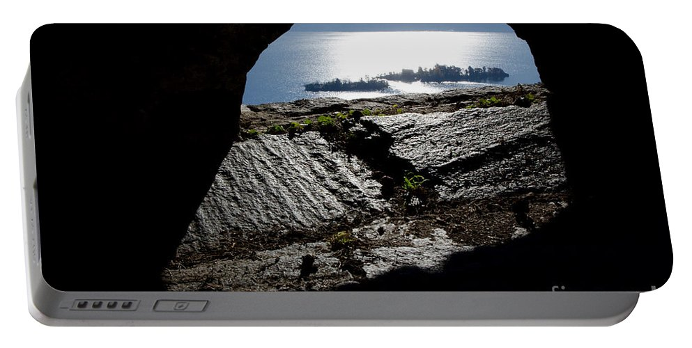 Islands Portable Battery Charger featuring the photograph Two Islands On A Lake With A Arch by Mats Silvan