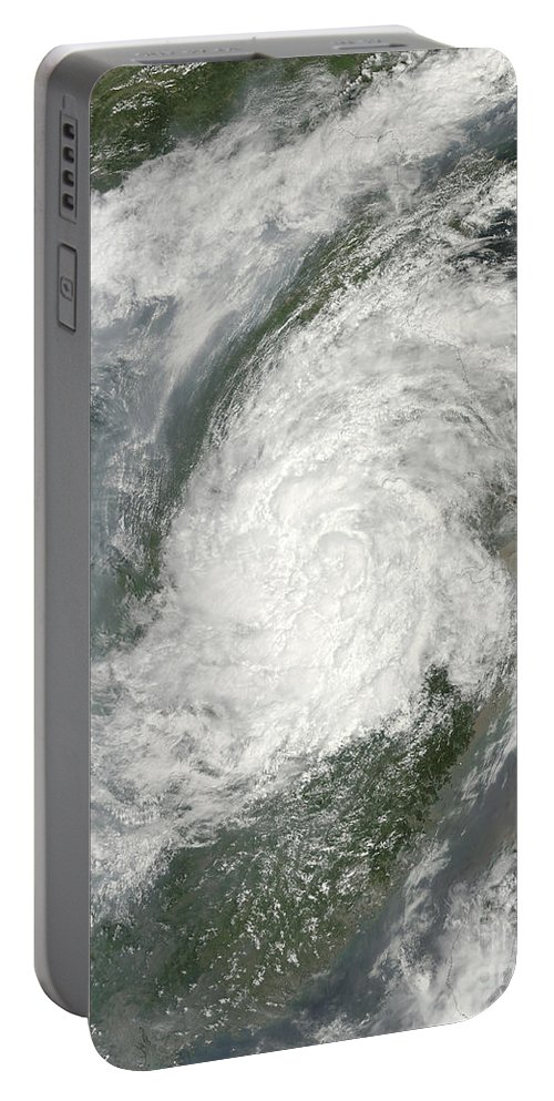 Color Image Portable Battery Charger featuring the photograph Typhoon Haikui Makes Landfall by Stocktrek Images