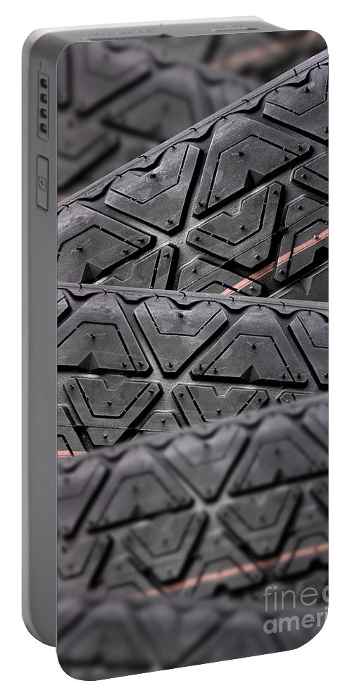 Automobile Portable Battery Charger featuring the photograph Tyres Stacked With Focus Depth by Simon Bratt Photography LRPS