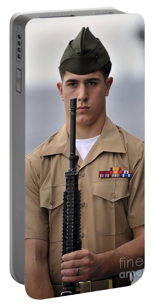 Salute Portable Battery Charger featuring the photograph U.s. Marine Presents Arms During An by Stocktrek Images
